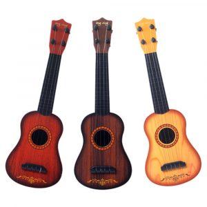 17 tums barns utbildningsplastik Ukulele Musical Toy fyra strängar för barn
